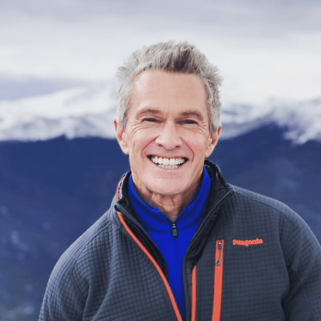 James Rouse in Front of Snow Capped Mountains