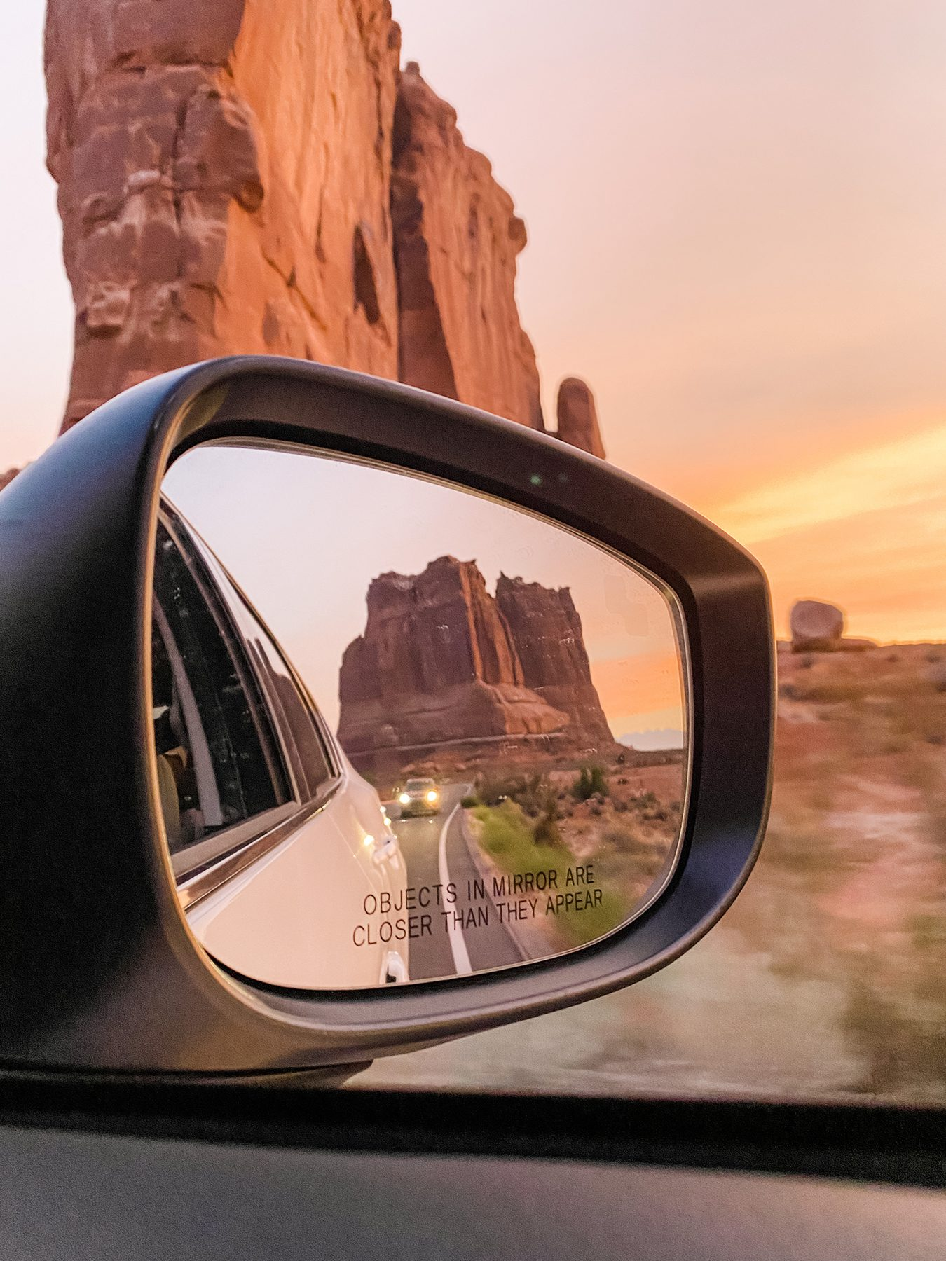 Grand canyon in the review mirror of a car